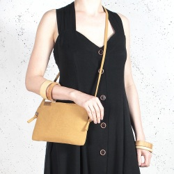 Nodo bag S mustard small clurch with a shouder belt
